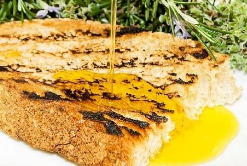 BOAST OF ROMAN FOOD TRADITION: BRUSCHETTA (garlic toast)
